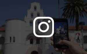 student taking photo of helper hall with Instagram logo overlay