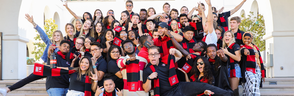 SDSU students wearing I AM SDSU scarves